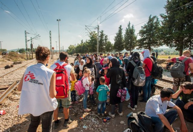MSF nurse, Stergios Voudouris, and doctor Stavroula Kostaki treat people at the border with Macedonia in Idomeni.